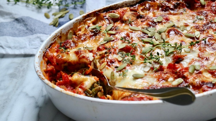 Vegetarian lasagna with halloumi, spinach and pumpkin seeds