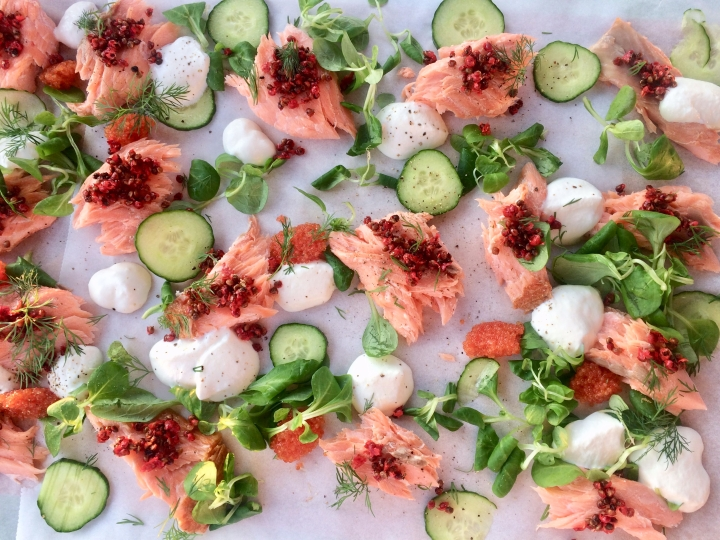 Hot smoked salmon with pink peppercorn, cucumber and sour cream