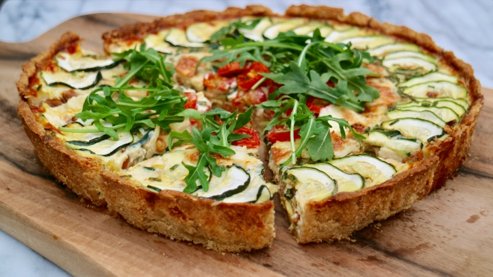 Quiche with spicy sausage, zucchini, tomatoes and mozzarella
