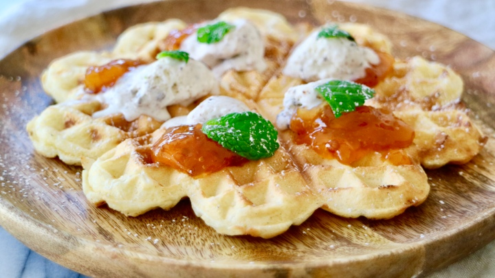 Waffle with cloudberry, ice cream and mint