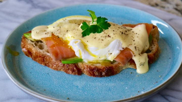 Eggs Benedict with salmon and avocado