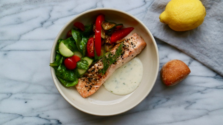 Whole wild salmon with dill sauce