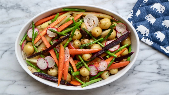 Summer salad with potatoes, radishes, asparagus and carrots