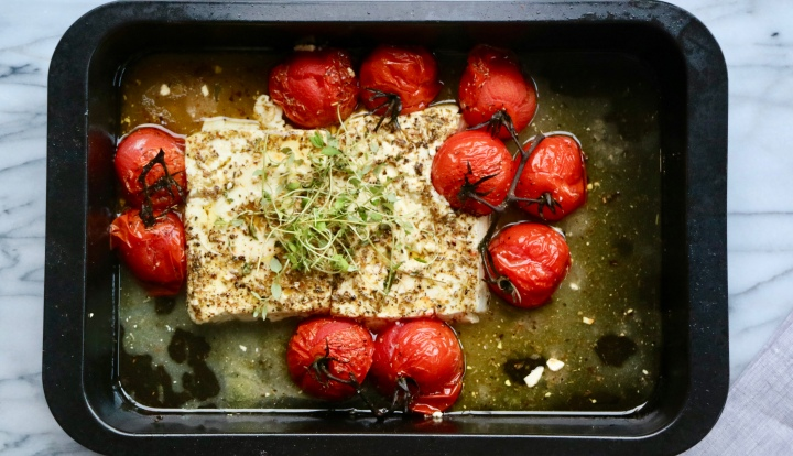 Whole grilled Feta cheese with tomatoes, oregano and oliveoil