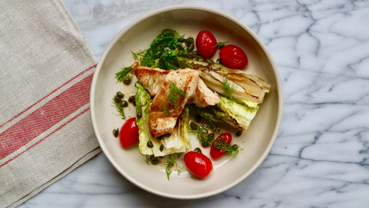 Grilled Snapper fillet with grilled little Gem lettuce, tomatoes and capers