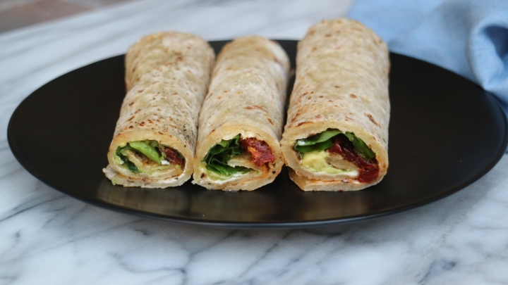 Norwegian flatbread (Lefse) with avocado, sun-dried tomatoes and spinach
