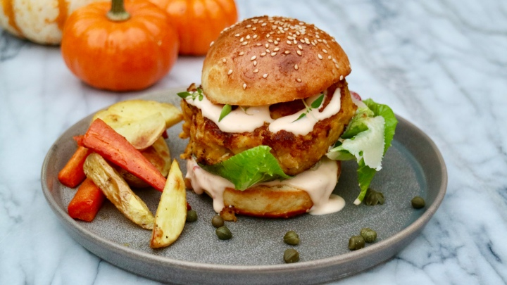 Halloween pumpkin burger with potato and carrot wedges