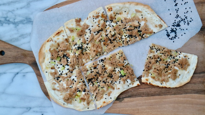 Flammkuchen with tuna, green onion and sesame seeds