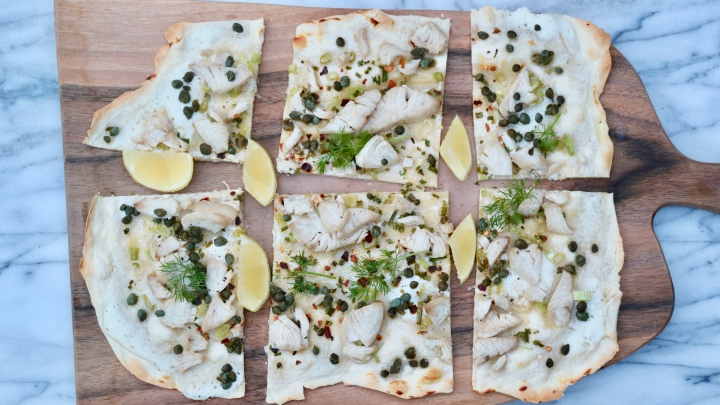 Flammkuchen with chili fish, green onion and capers