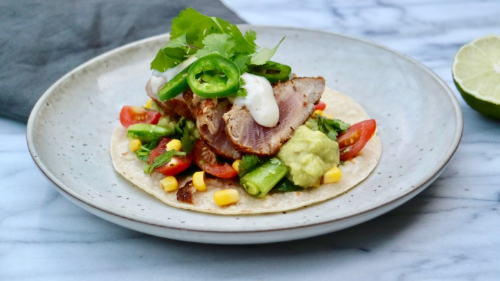 Fish taco with grilled tuna, tomato salad and lime aioli