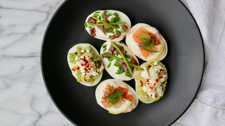 Easter deviled eggs with smoked salmon, avocado and anchovy