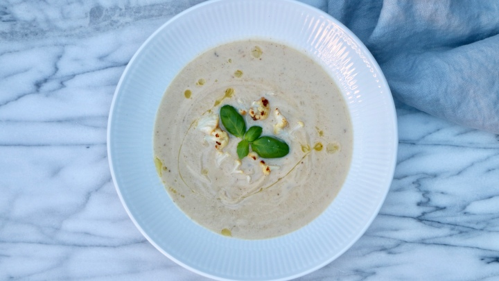 Cauliflower soup with grilled cauliflower buds and truffle