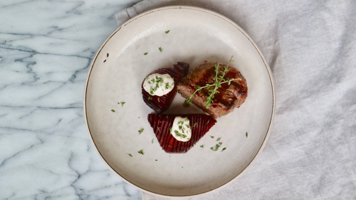 Beef tenderloin with Hasselback red beets, goat cheese sauce and fresh thyme