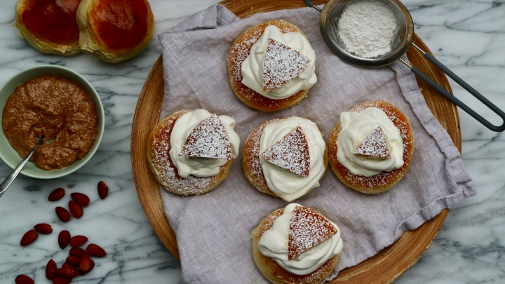 Swedish Semla with roasted almond filling (filled cardamom bun)